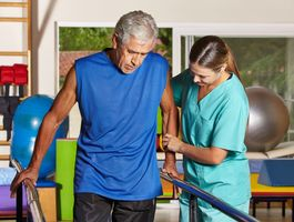 A rehabilitation physician helping a patient